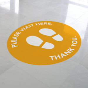Please wait here yellow vinyl floor circle